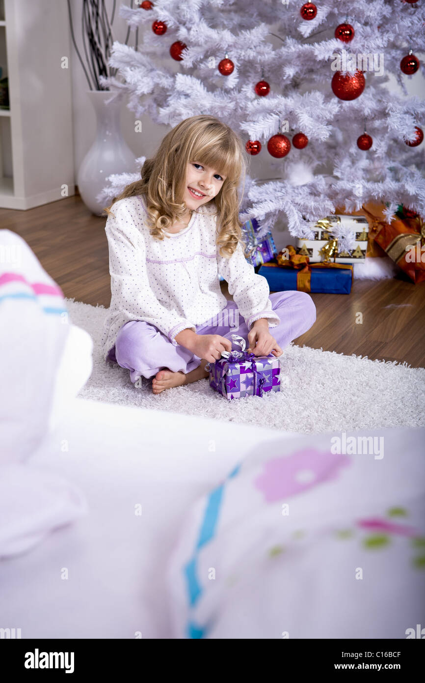 xmas girl in bed - Stock Image