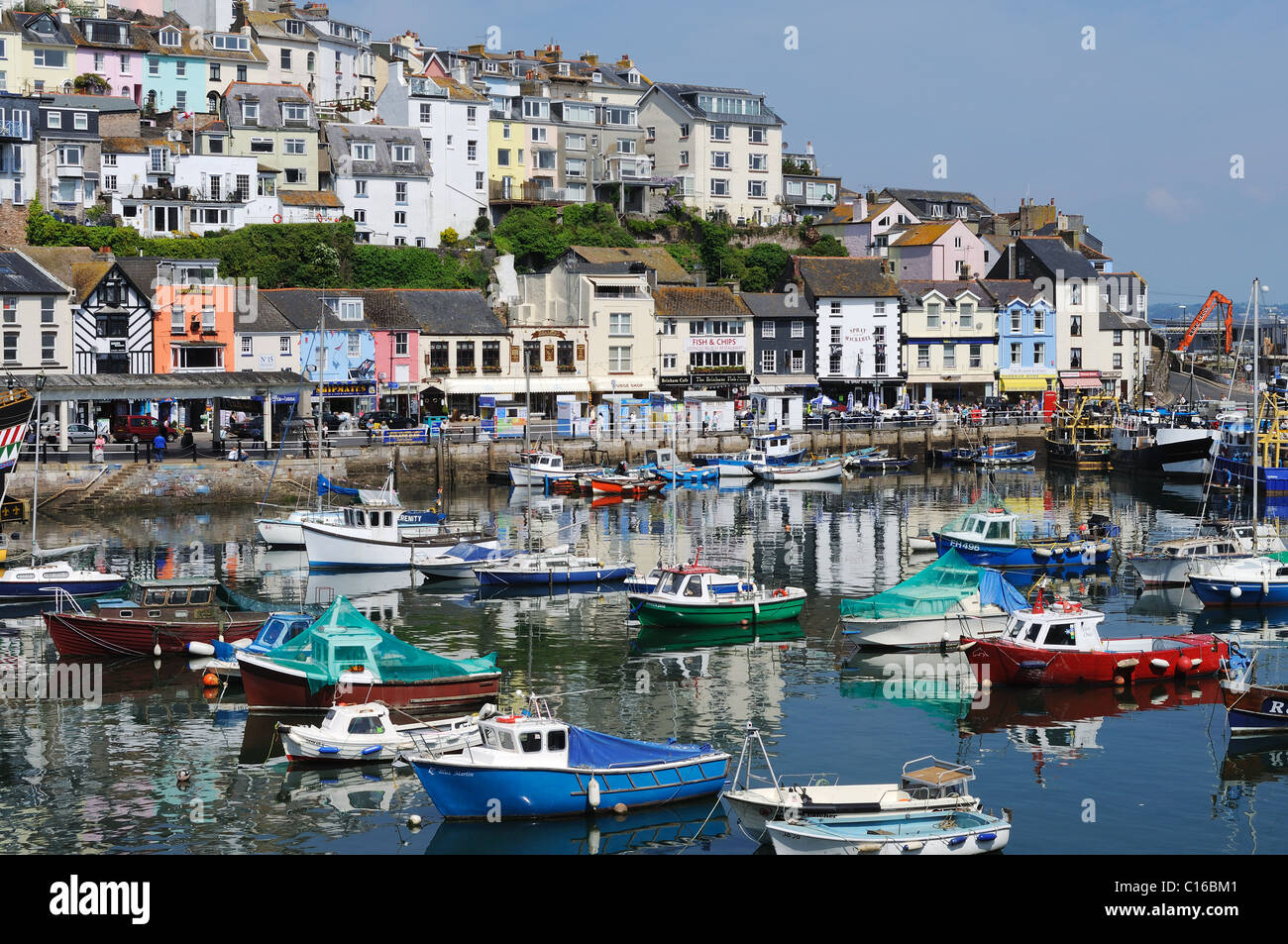 boats moored in the harbour at brixham, devon, uk - Stock Image