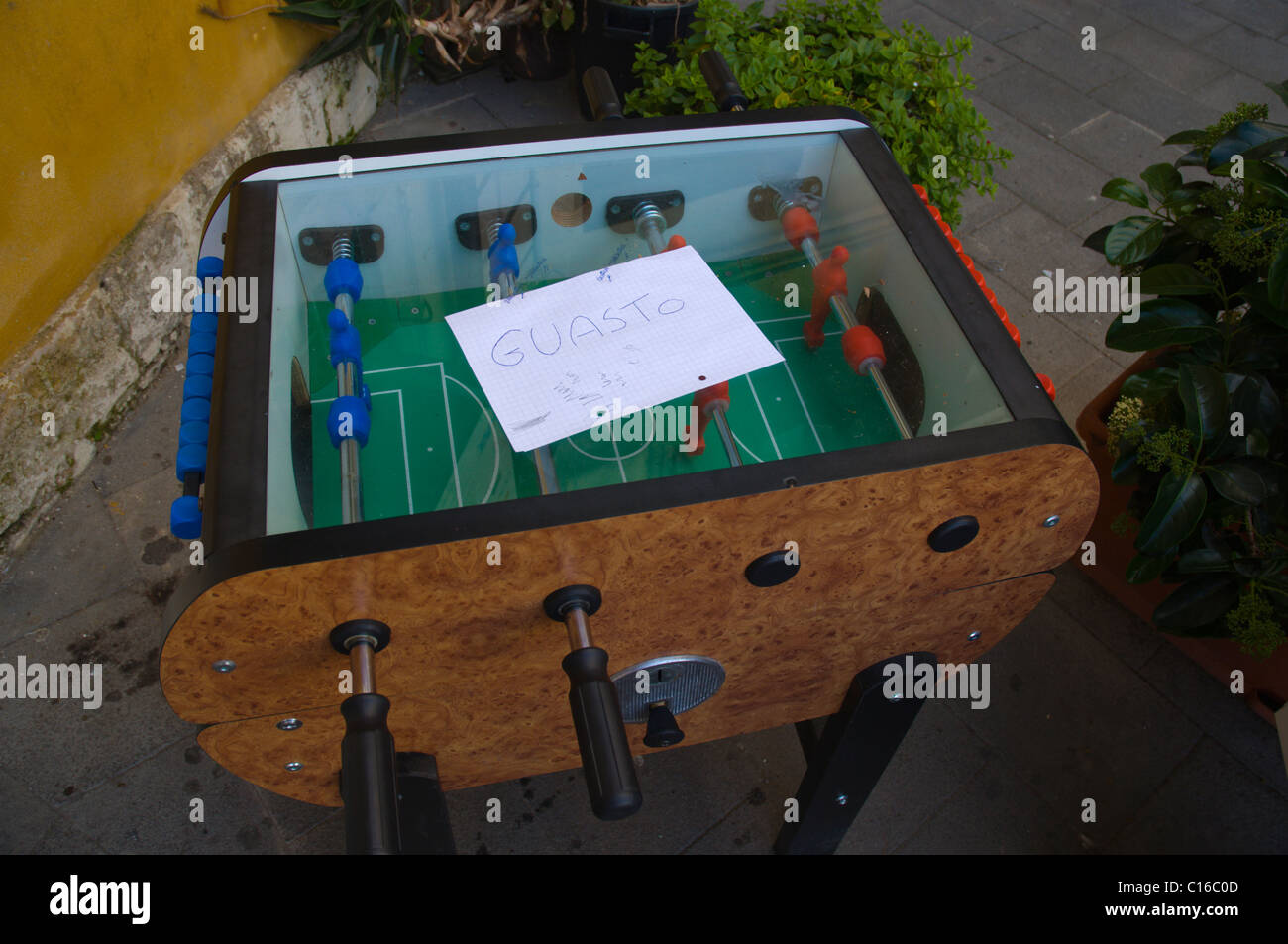 Broken table football table for children Syracuse Sicily Italy Europe - Stock Image