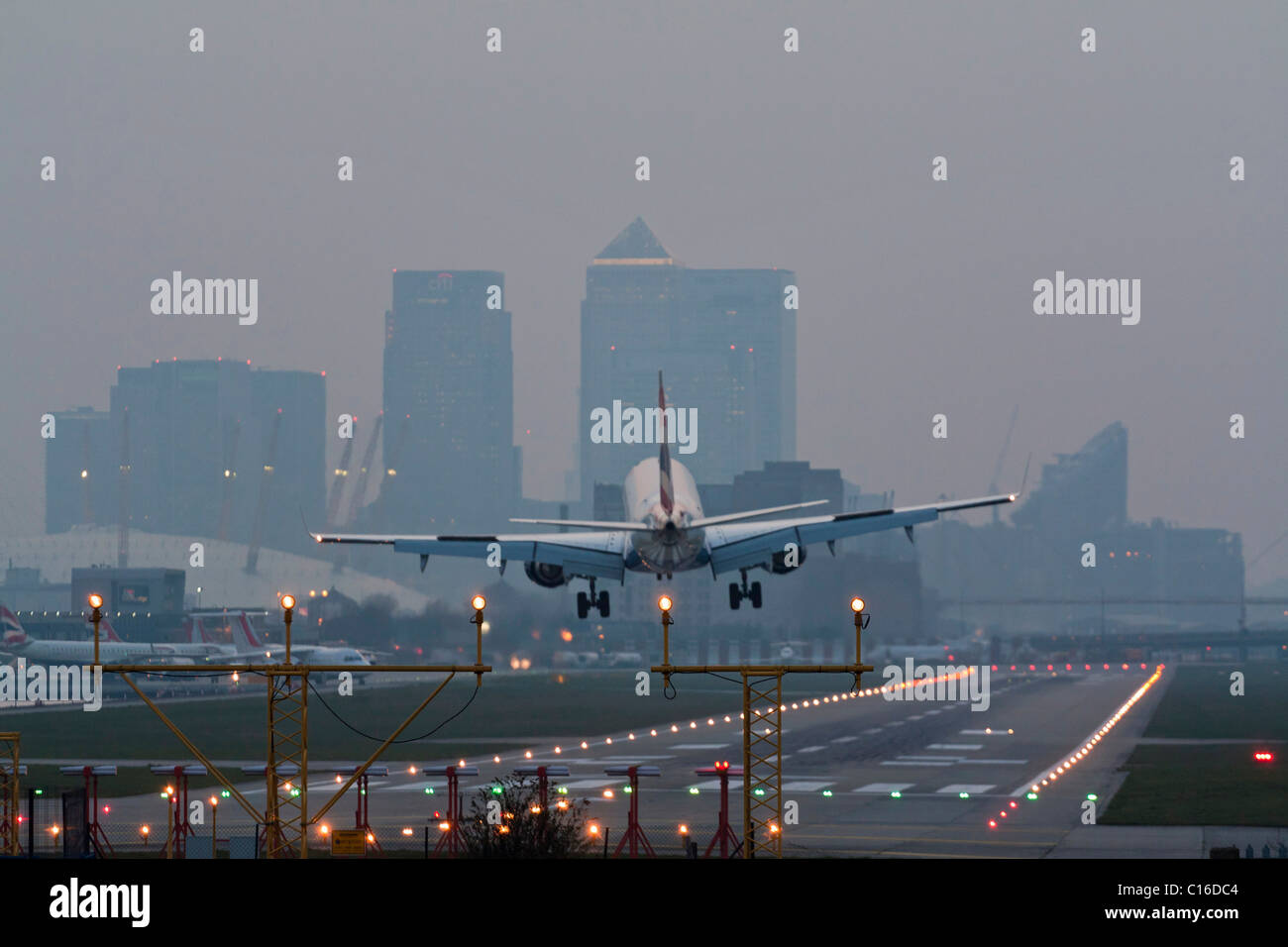 Airbus A318 Landing - London City Airport - Docklands - Stock Image