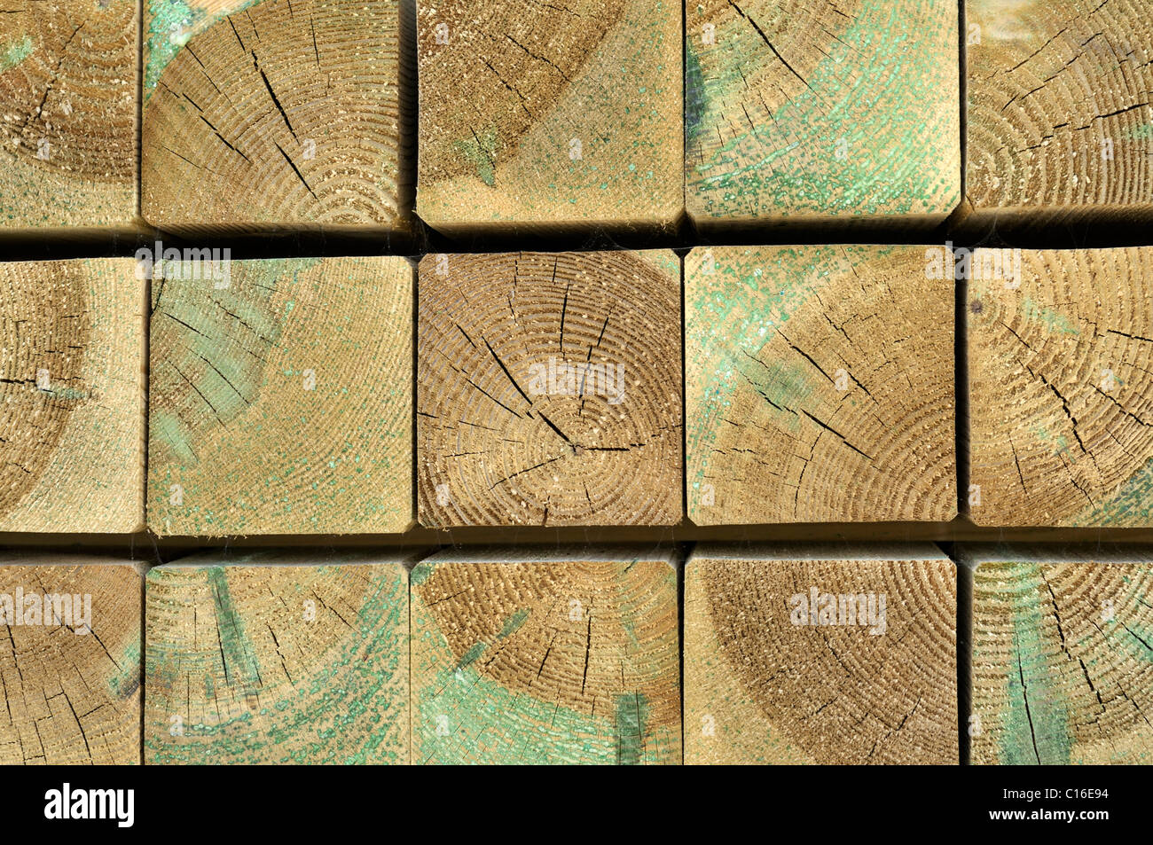 Impregnated, stacked rectangular blocks of wood, texture, front - Stock Image
