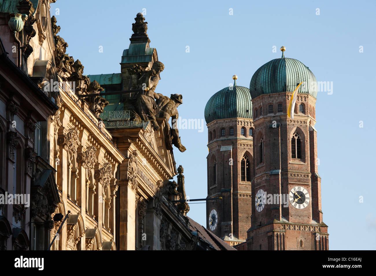 Palace in Kardinal-Faulhaber Street 10 and Frauenkirche Cathedral, Munich, Bavaria, Germany, Europe Stock Photo