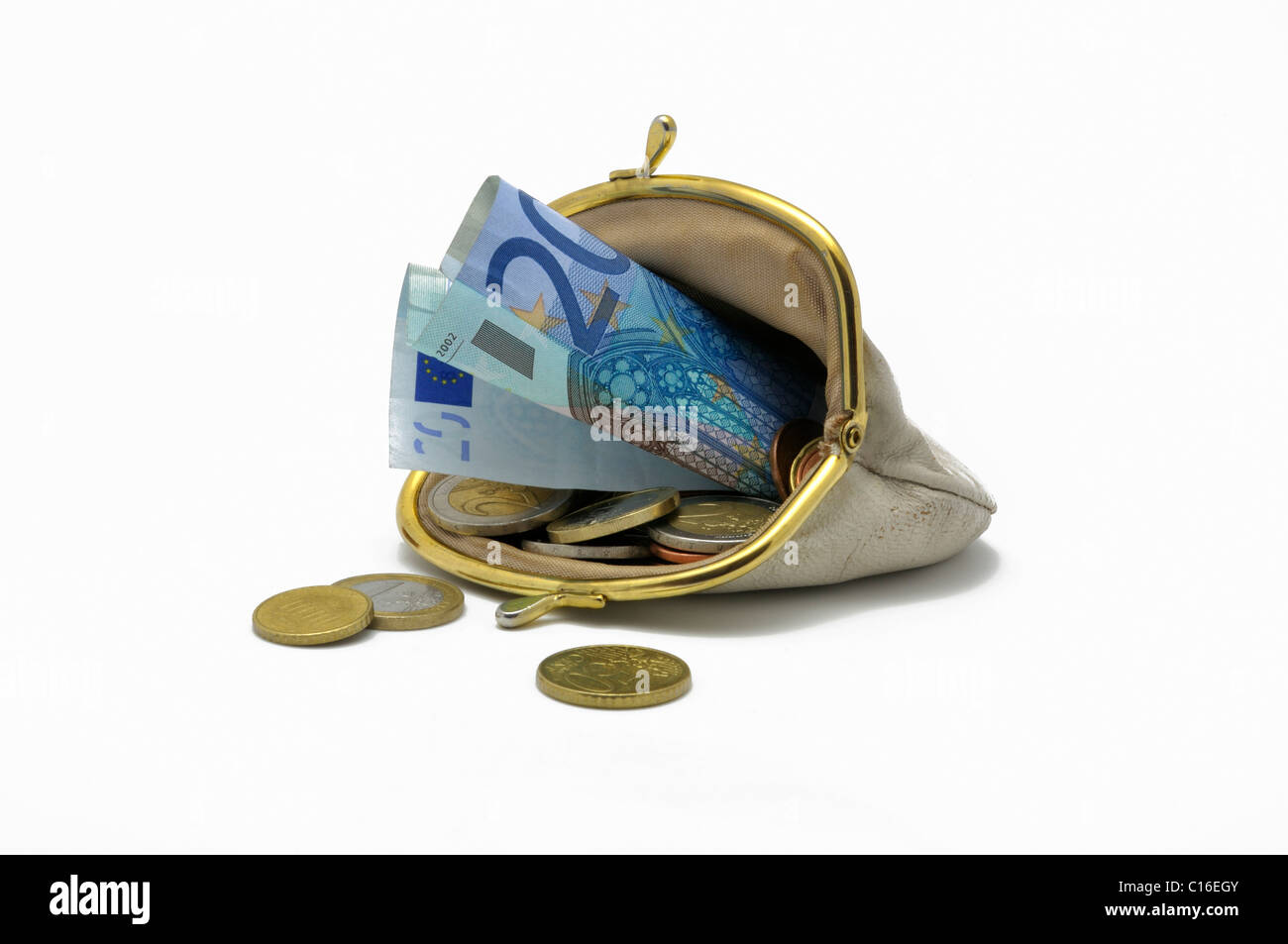 White, hackneyed purse with clip mechanism, filled with a 20 Euro banknote and various Euro coins - Stock Image
