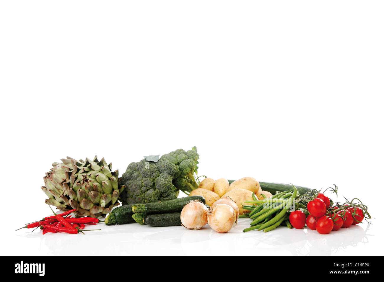 Mixed vegetables, artichokes, broccoli, potatoes, zucchini, onions, beans, cucumber, tomatoes and chillies Stock Photo