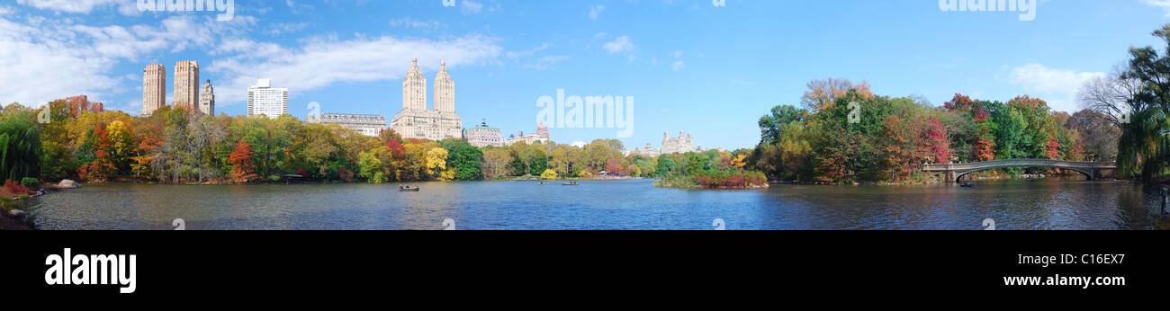 New York City Central Park panorama view in Autumn with Manhattan skyscrapers and colorful trees with Bow Bridge Stock Photo