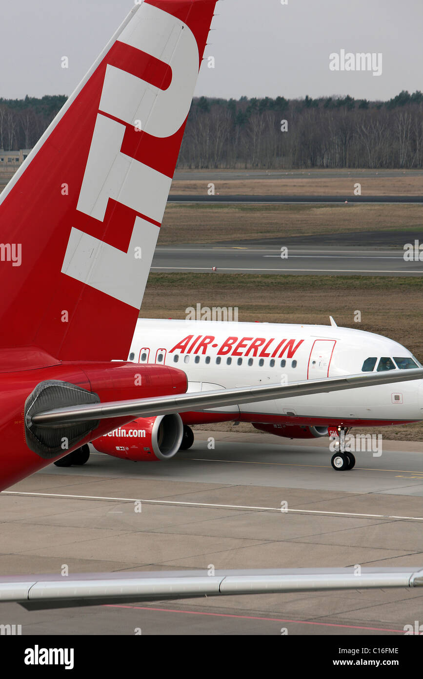 Competitors, aeroplanes of the airlines LTU and Air Berlin, Otto Lilienthal Berlin Tegel Airport, Berlin, Germany, - Stock Image