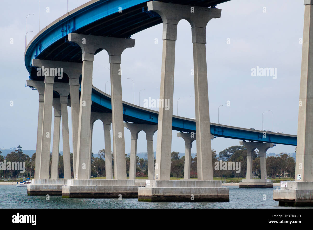 Mission-arched shaped concrete towers resting on pre-stressed reinforced concrete piles supporting curved Coronado - Stock Image