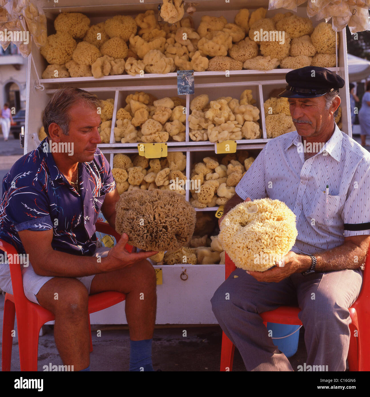 Man selling sponges, Kos, The Dodecanese, South Aegean Periphery, Greece - Stock Image