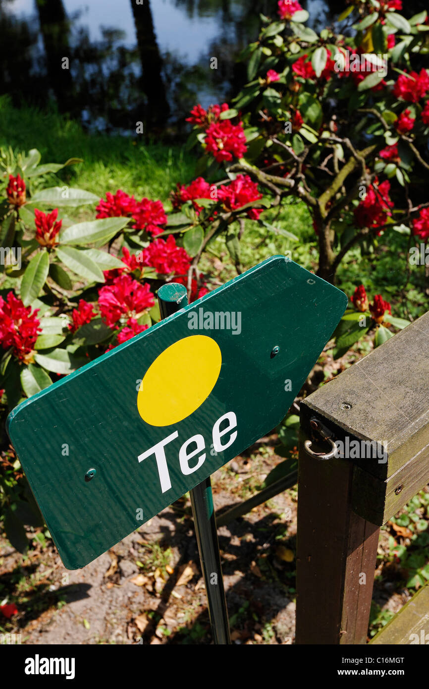 A guide post reading 'tea' at a golf course, Germany, Europe - Stock Image