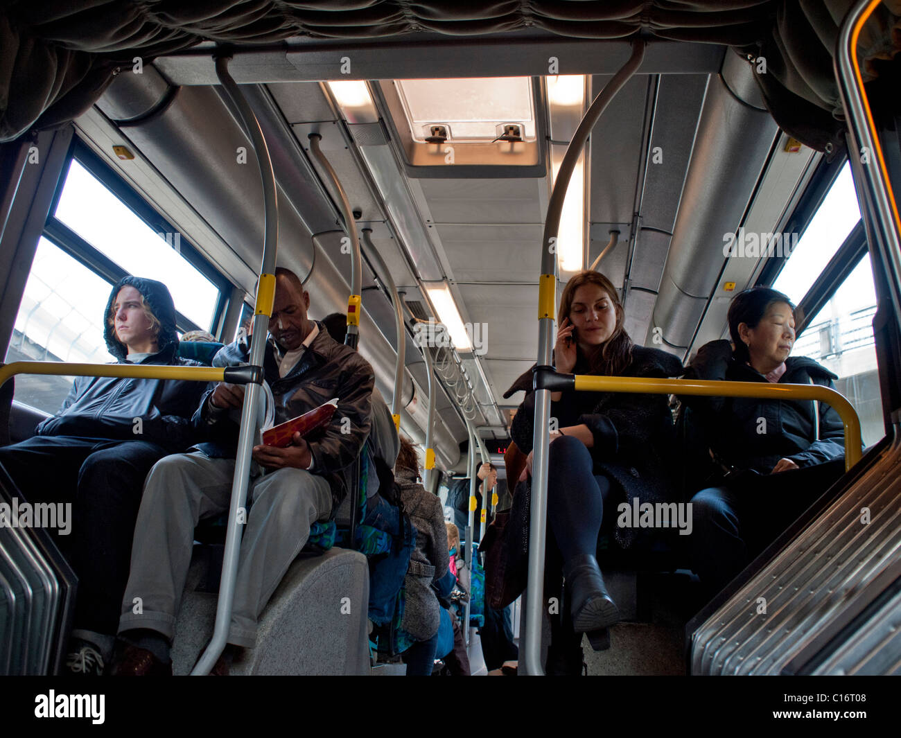 Multi ethnic passengers on a city bus in Stockholm Sweden - Stock Image