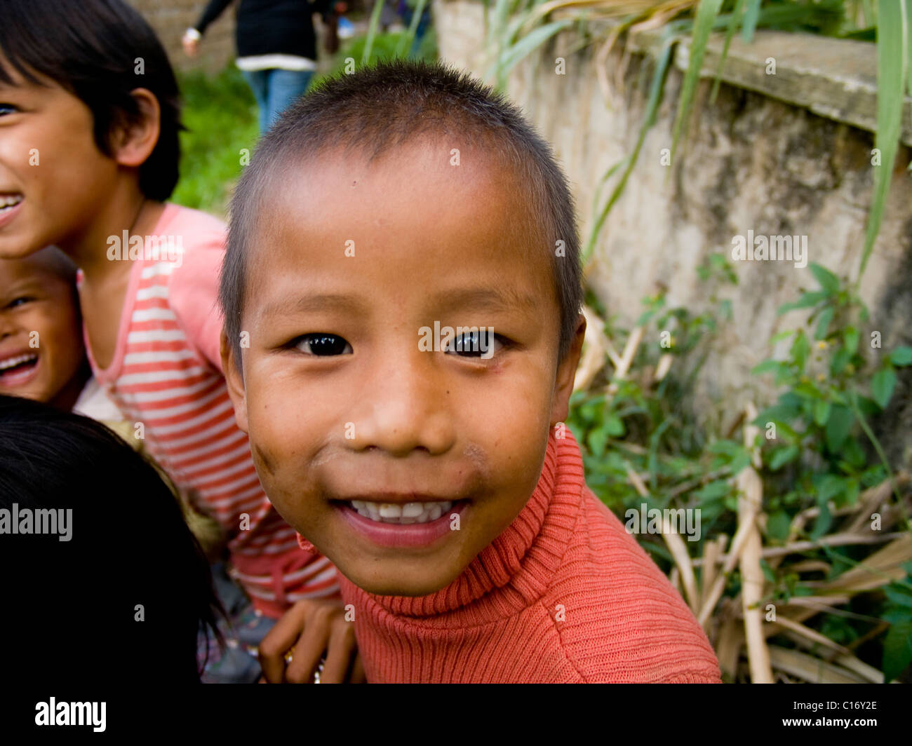 Young playing Bhutanese boys - Stock Image