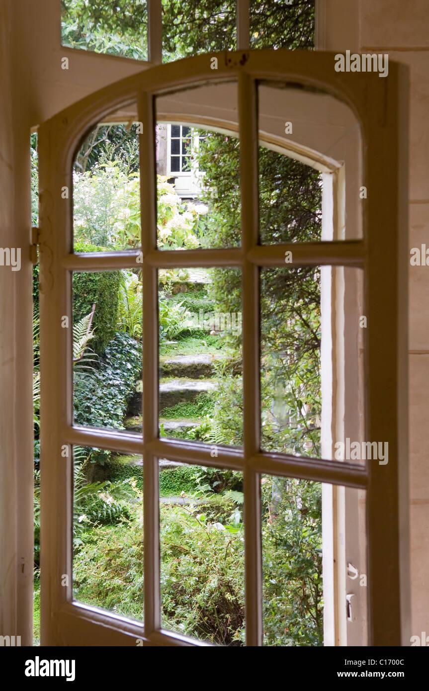 View through open glass paned door to overgrown garden - Stock Image & Open Door Secret Garden Stock Photos u0026 Open Door Secret Garden Stock ...