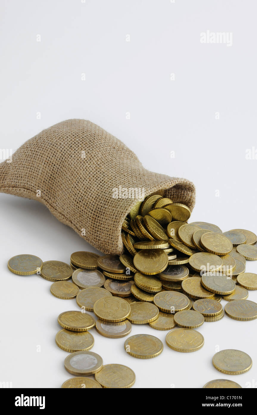 Tipped over money bag with euro coins - Stock Image