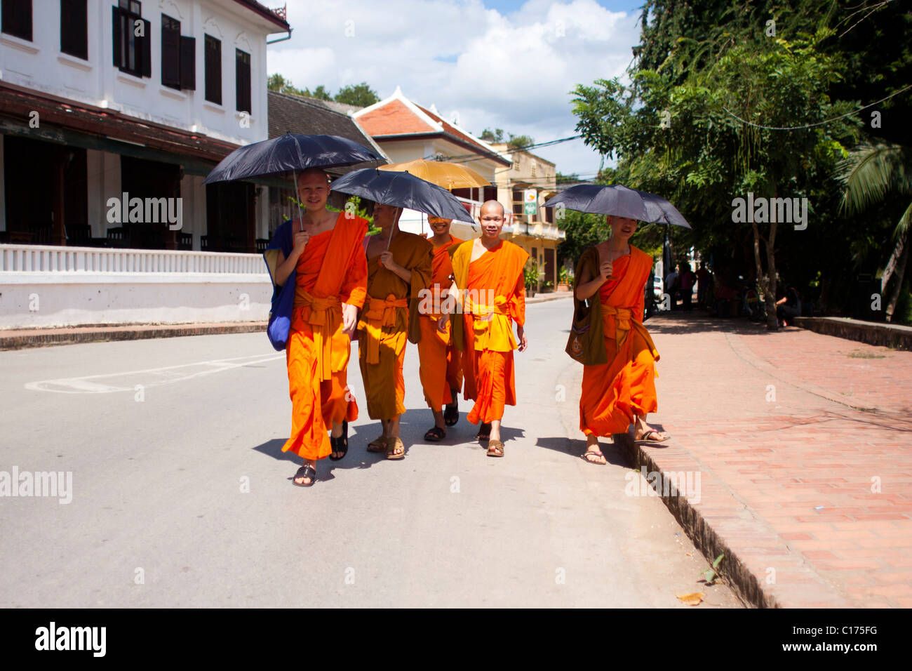 Monks on the streets of Luang Prabang, Laos, Asia - Stock Image