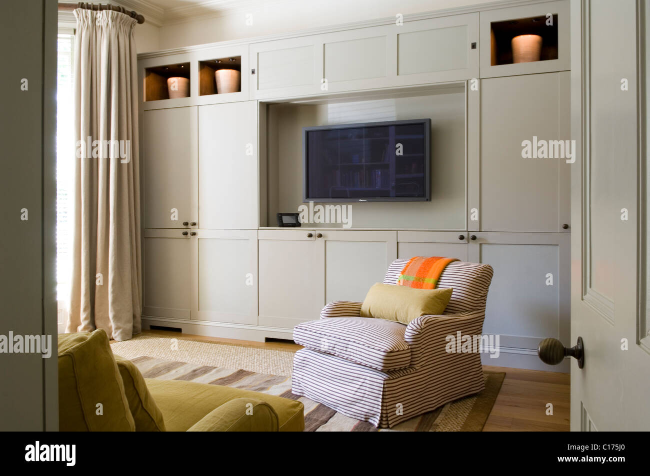 flat screen tv in living room with built in cupboards and armchair rh alamy com Living Room with Flat Screen flat screen tv in small living room