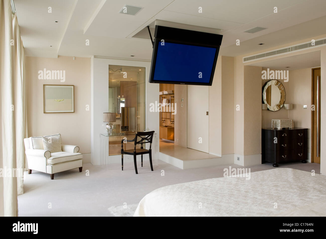 Charmant Flat Screen Plasma TV Mounted To The Ceiling In Modern Bedroom With Armchair