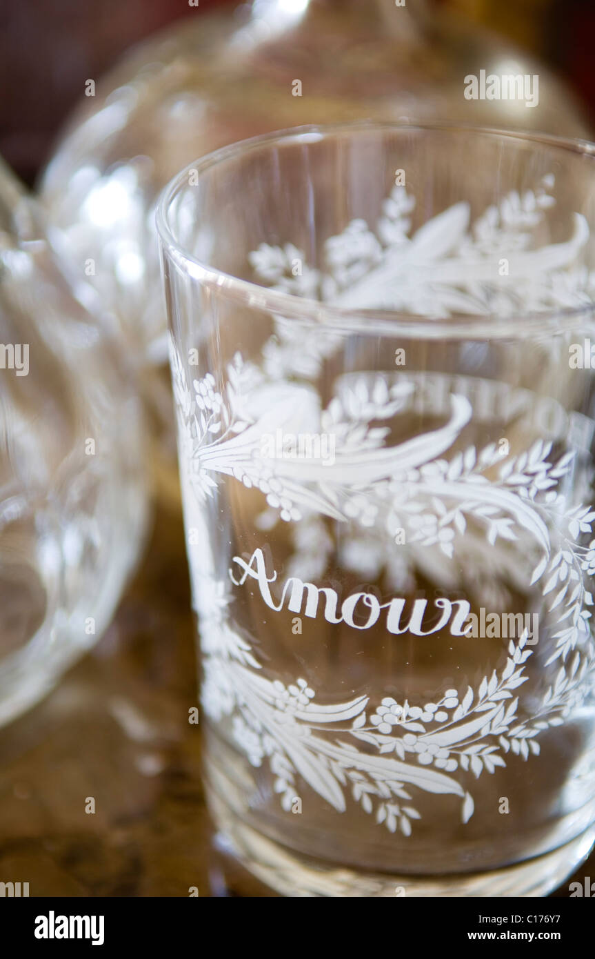 Drinking glass with the word 'amour' etched into it - Stock Image
