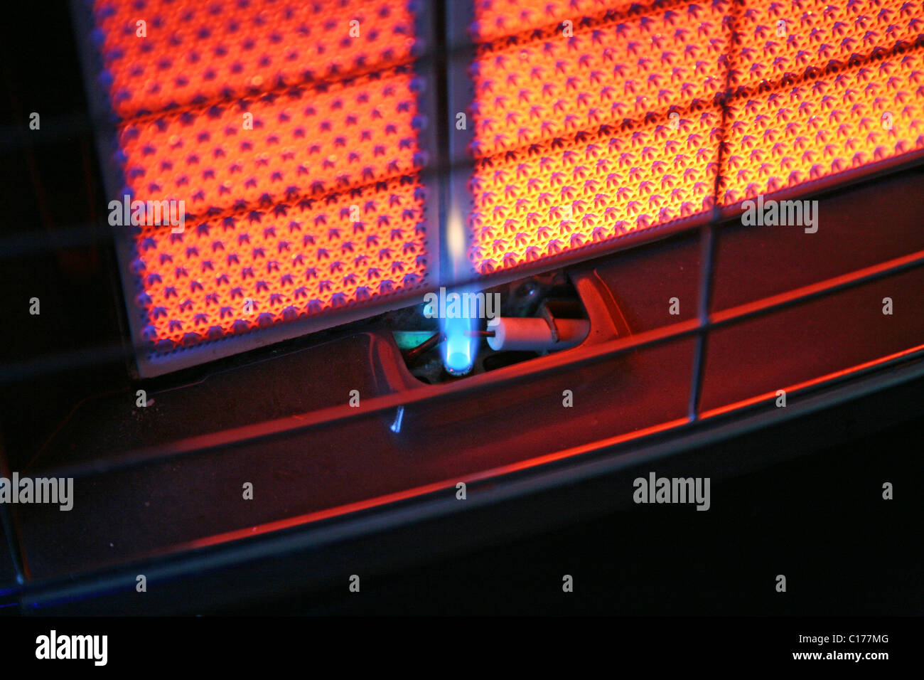 The Pilot Light On A Butane Gas Heater With The Red Fire Bricks Lit Up