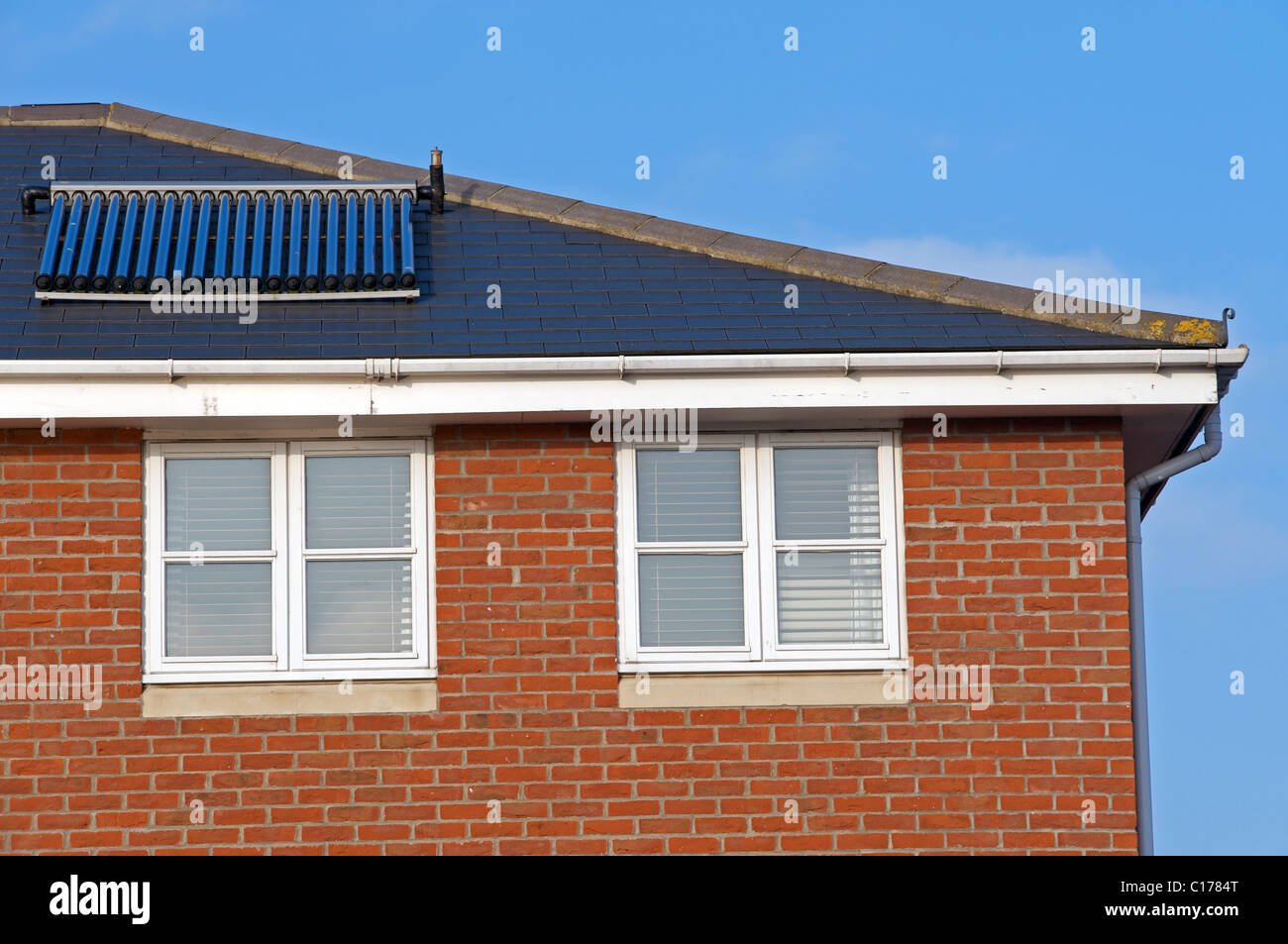 Evacuated solar energy tubes producing hot water for a residential property, Ipswich, UK. - Stock Image