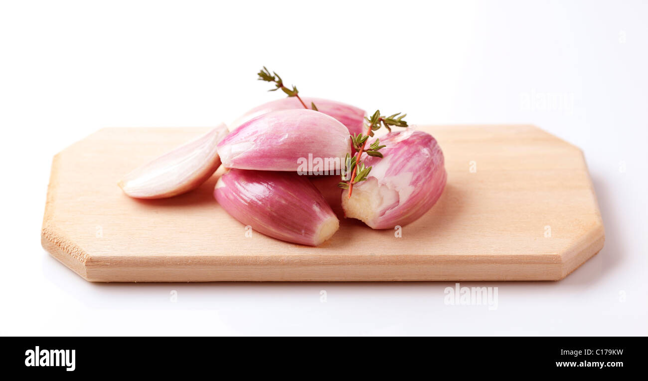 Bulbs of Spanish onion on a cutting board - Stock Image