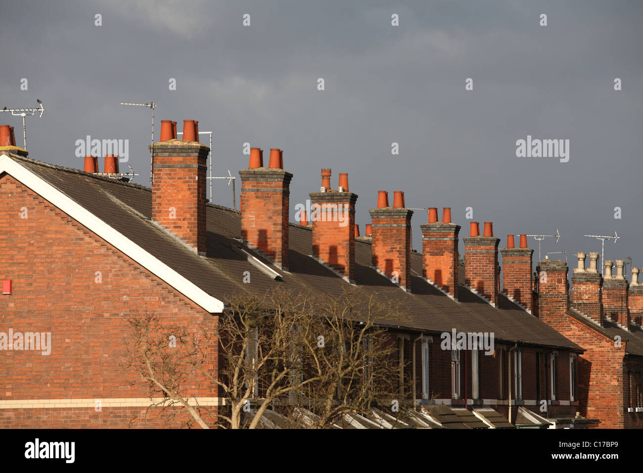 Chimneys on row of terrace houses - Stock Image