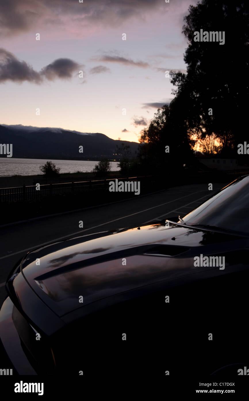 Black 2010 Dodge Challenger retro muscle car at twilight in Lake Elsinore California - Stock Image