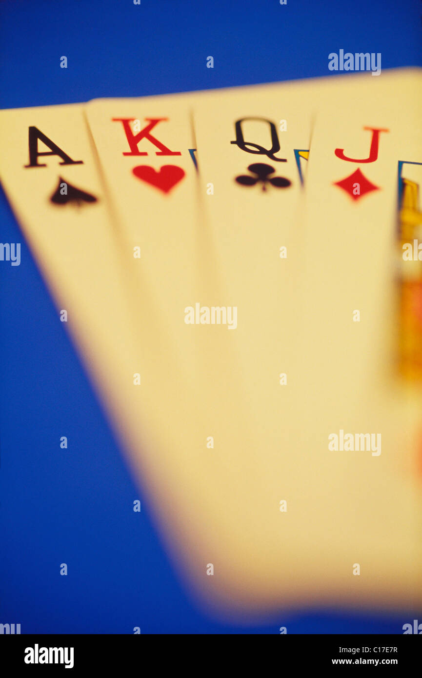 VHM-66711 : Concept ; ace king queen jack cards on blue background - Stock Image