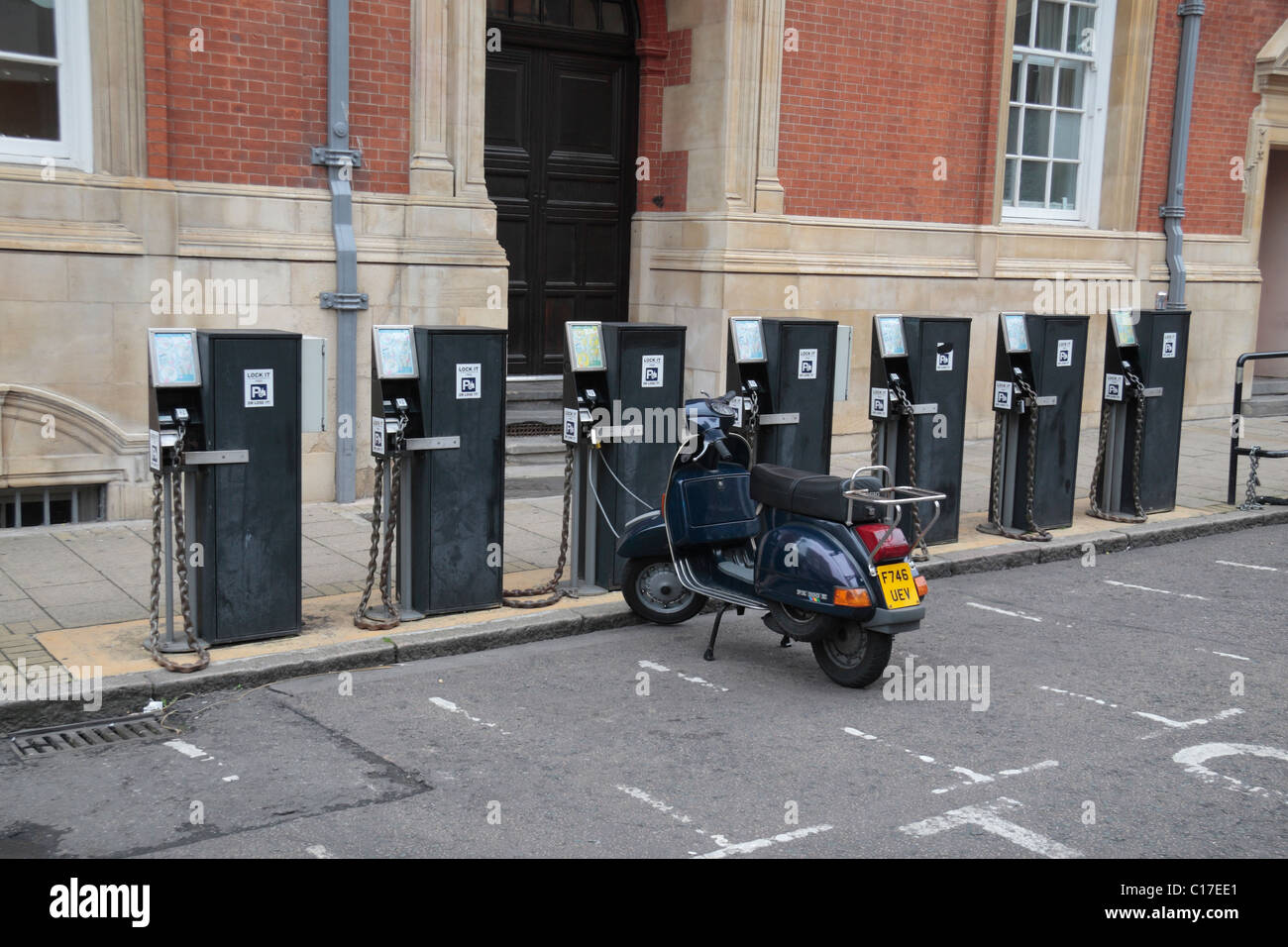 A motorbike parking area with parking machines/meters close to the town centre of Leicester, Leicestershire, England. - Stock Image