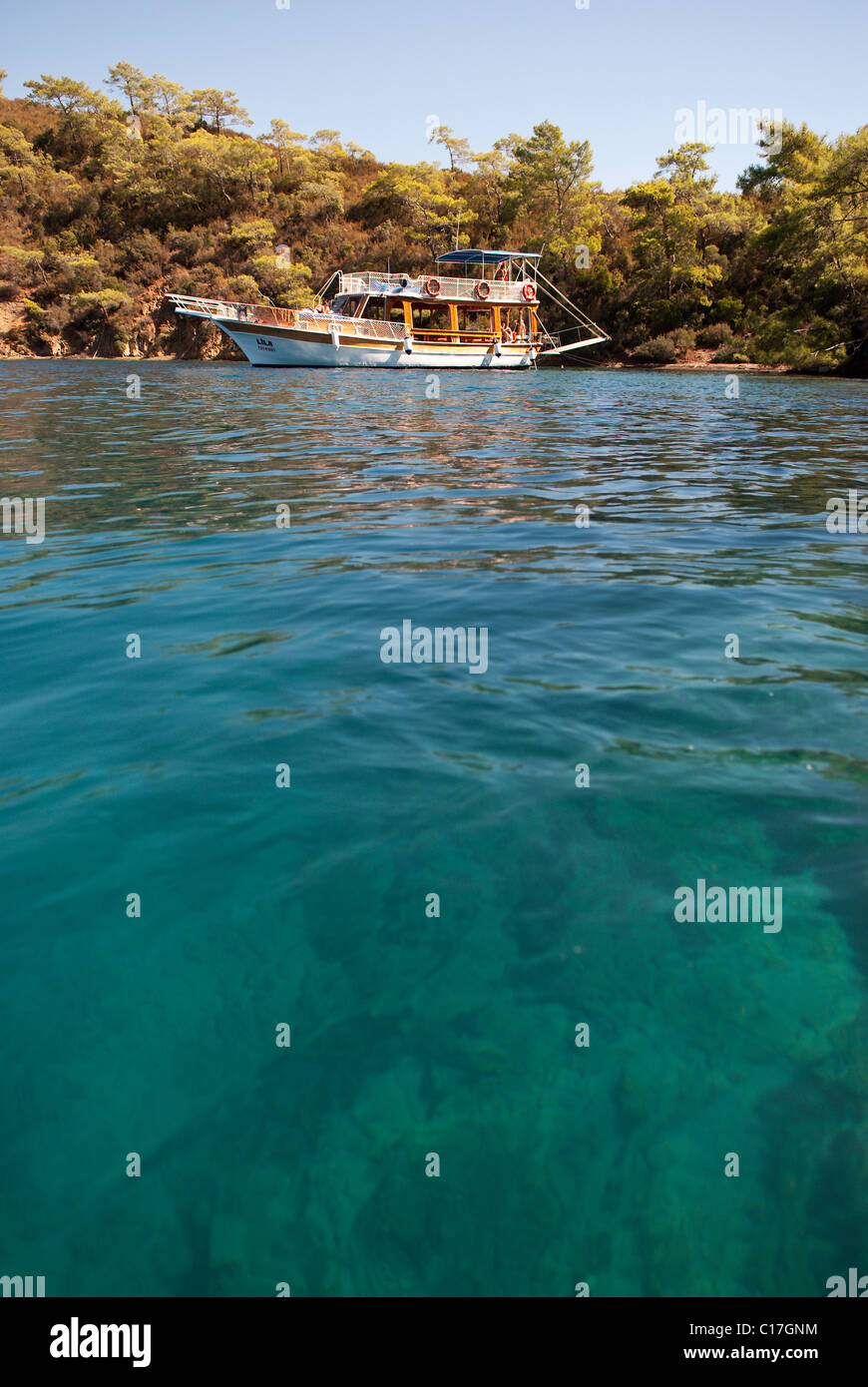 Turkish Gulet anchored in clear turquise water on the Lycian coast - Stock Image