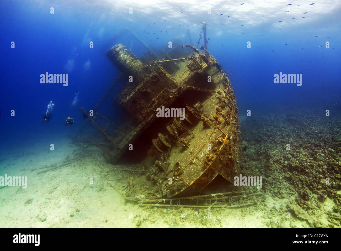 Scuba divers approach the stern of the Giannis D shipwreck at Sha'ab Abu Nuhas in the Red Sea Straits of Gubal, - Stock Image