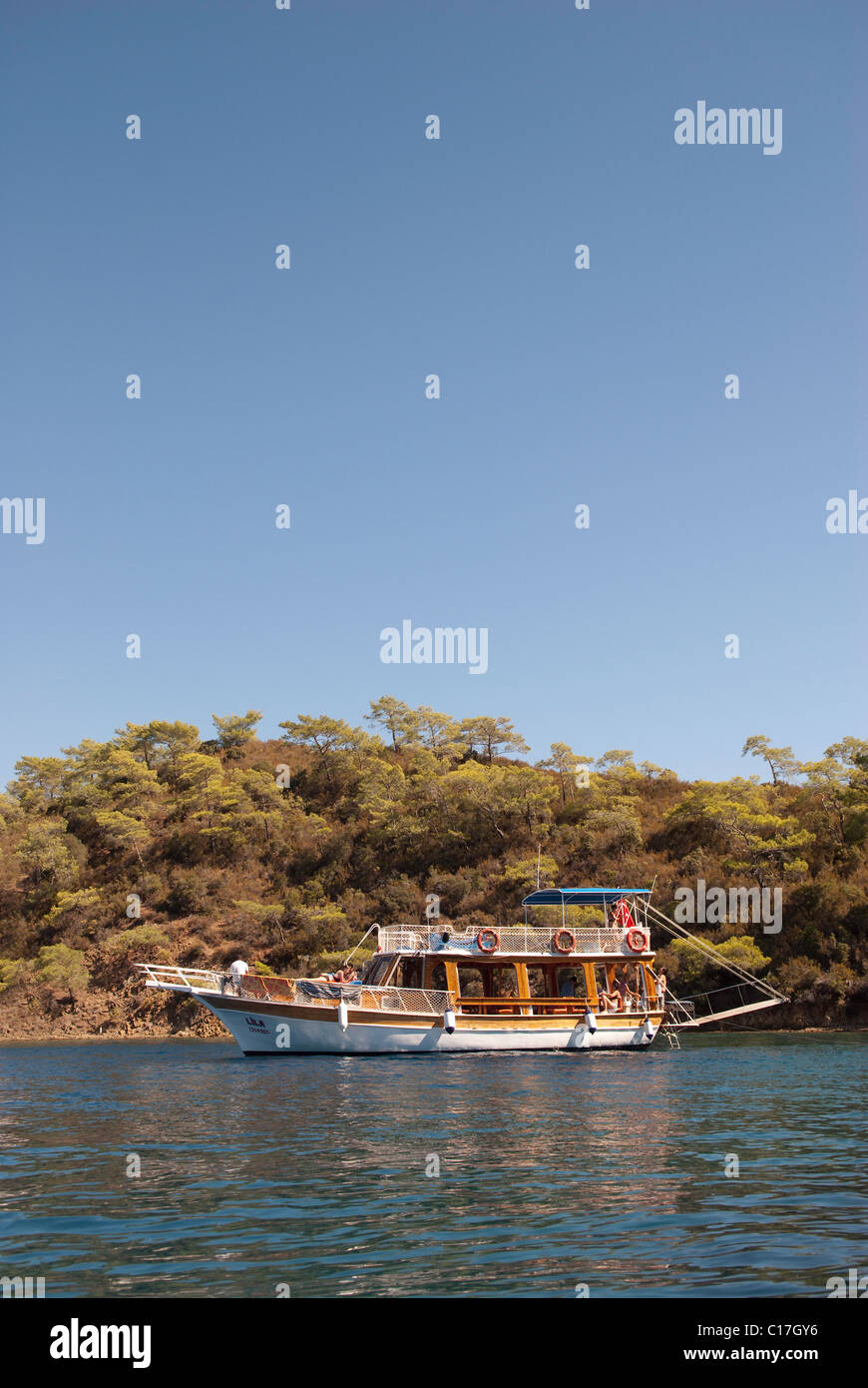 Turkish Gulet anchored of an island on the Lycian coast - Stock Image