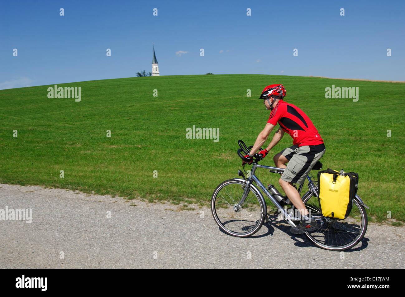 Bicyclist near Gars am Inn, Chiemgau, Bavaria, Germany, Europe - Stock Image