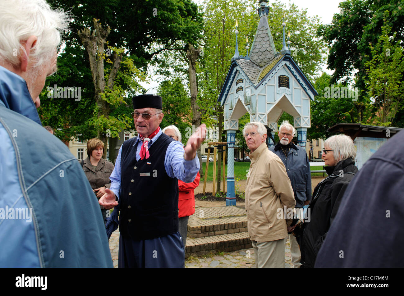 City guide and party during guided city tour in Friedrichstadt, North Frisia, Schleswig-Holstein, Germany, Europe - Stock Image