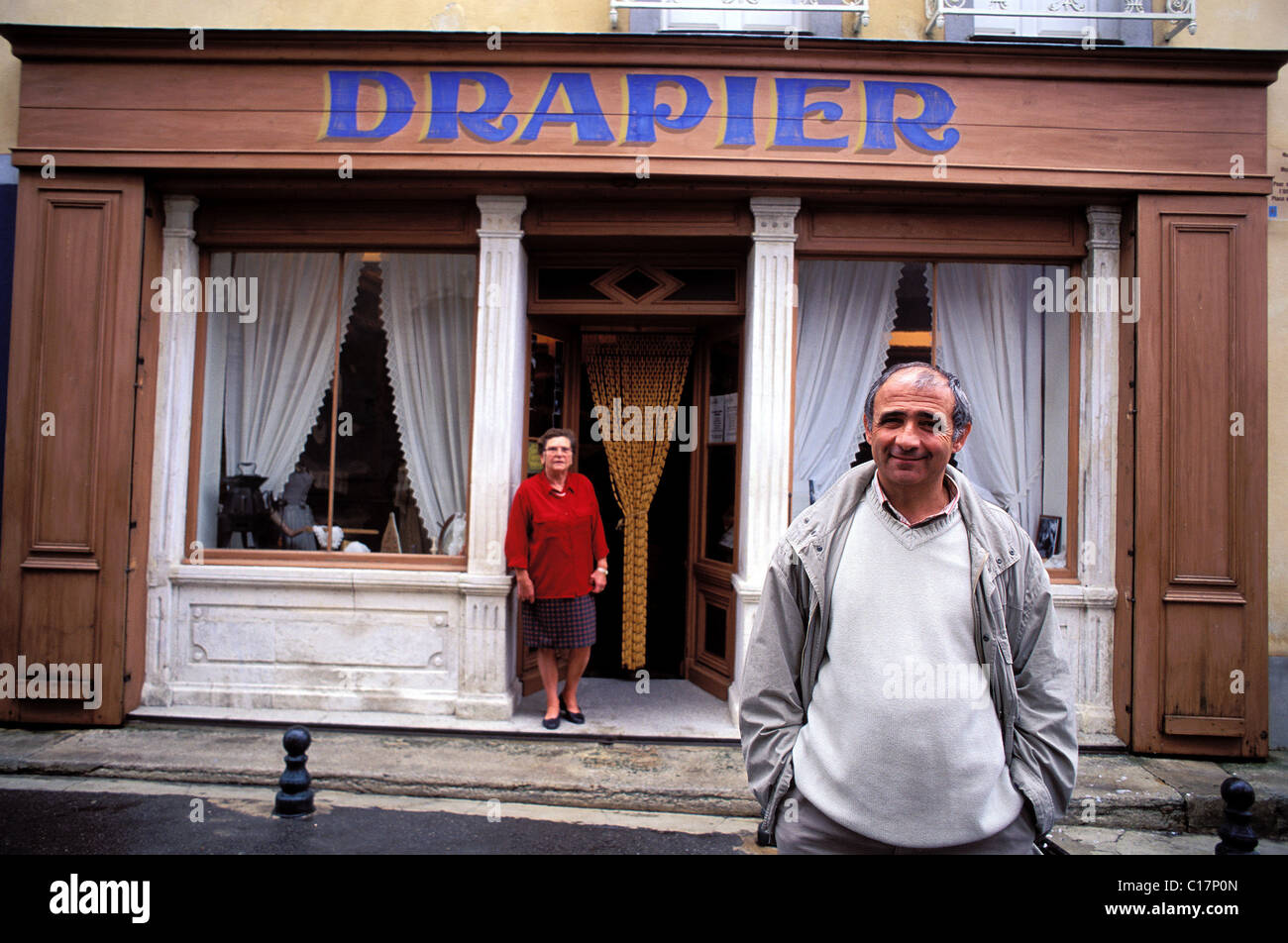 France Vaucluse Pernes les Fontaines mayor mr gabert in front of the former draper shop & now the costume museum - Stock Image