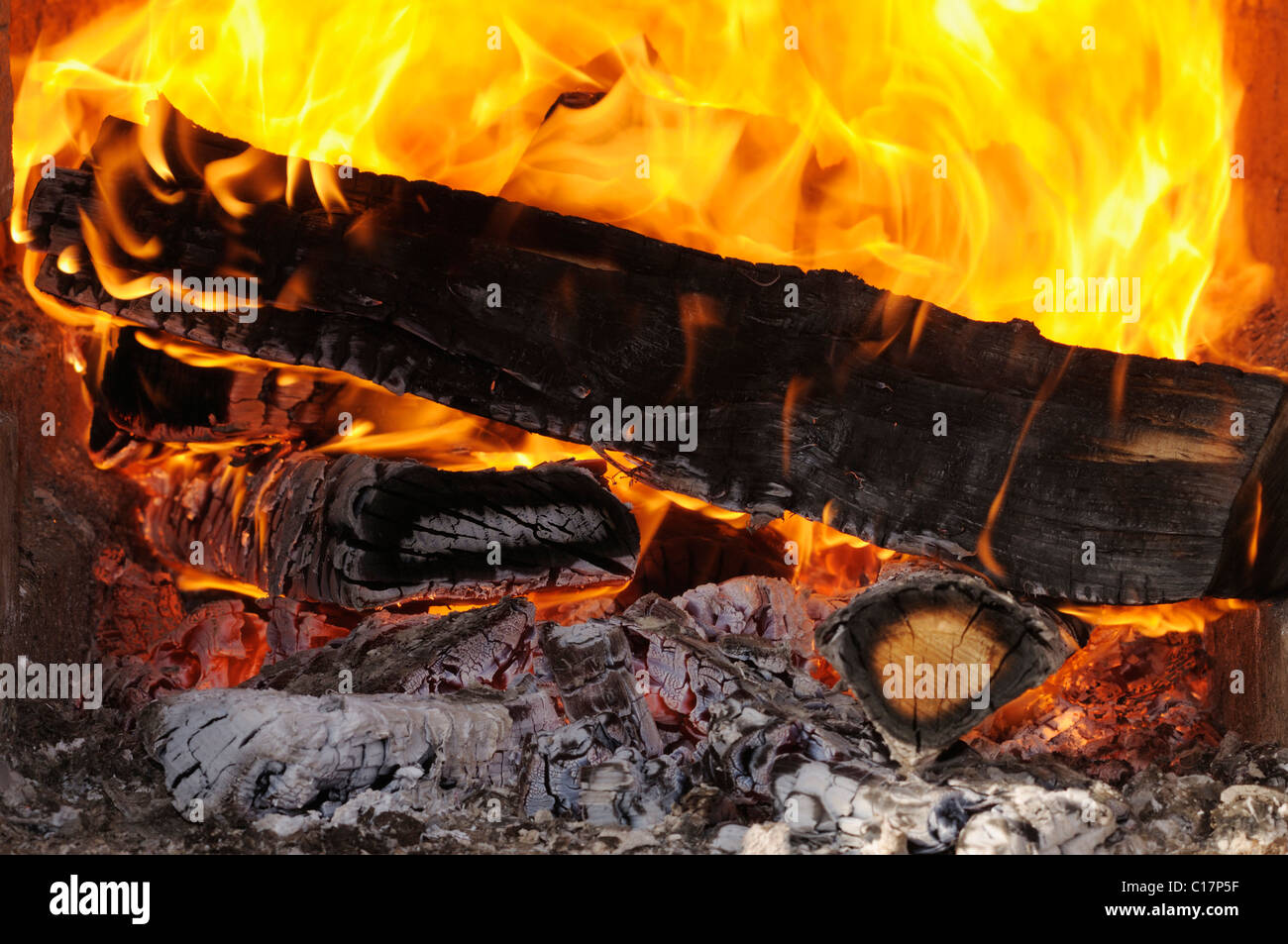 Wood fire, blazing, red hot logs, large flames - Stock Image