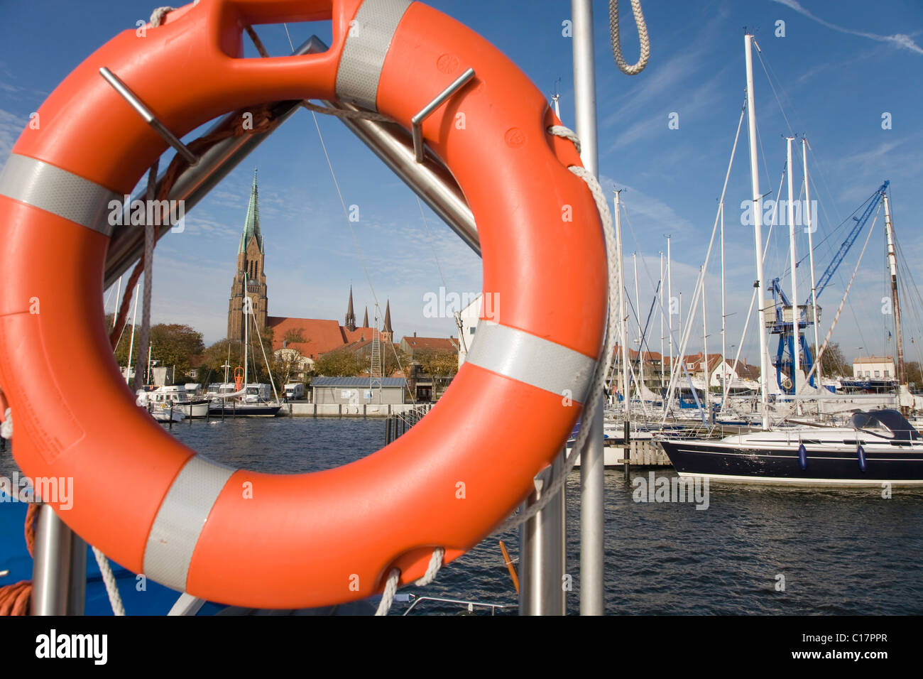 Life ring, sailboat marina with St. Petri Dom, St. Peter's Cathedral in the background, Schleswig an der Schlei, Stock Photo
