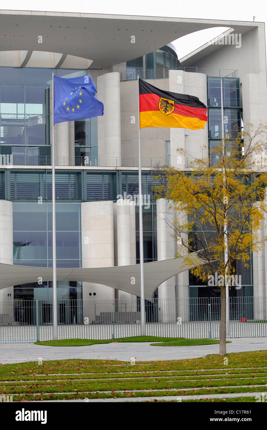 European and German flags in front of the Kanzleramt, German Chancellery in Berlin, Germany, Europe - Stock Image