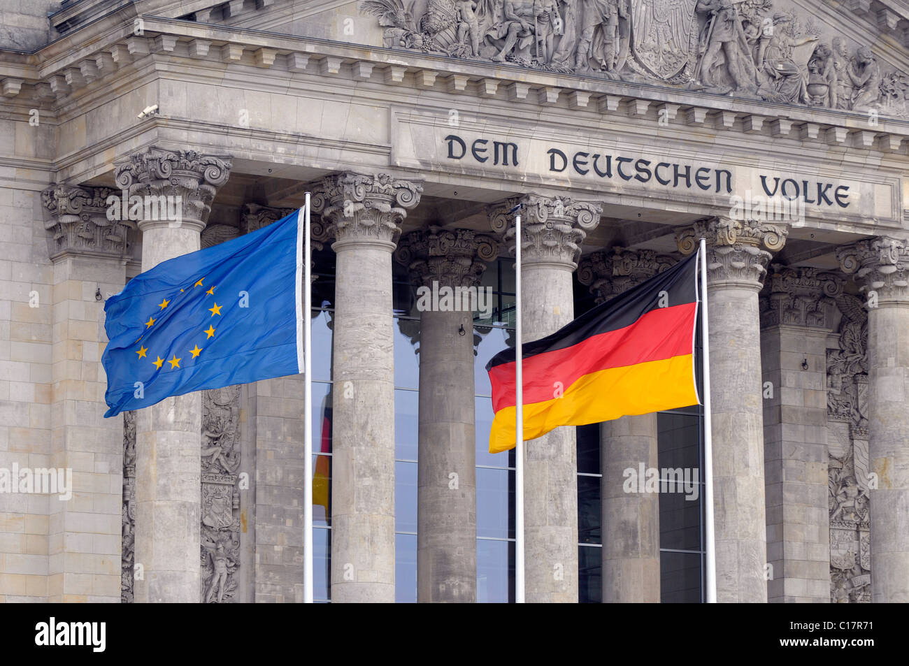 European and German flags in front of the Reichstag in Berlin, Germany, Europe - Stock Image