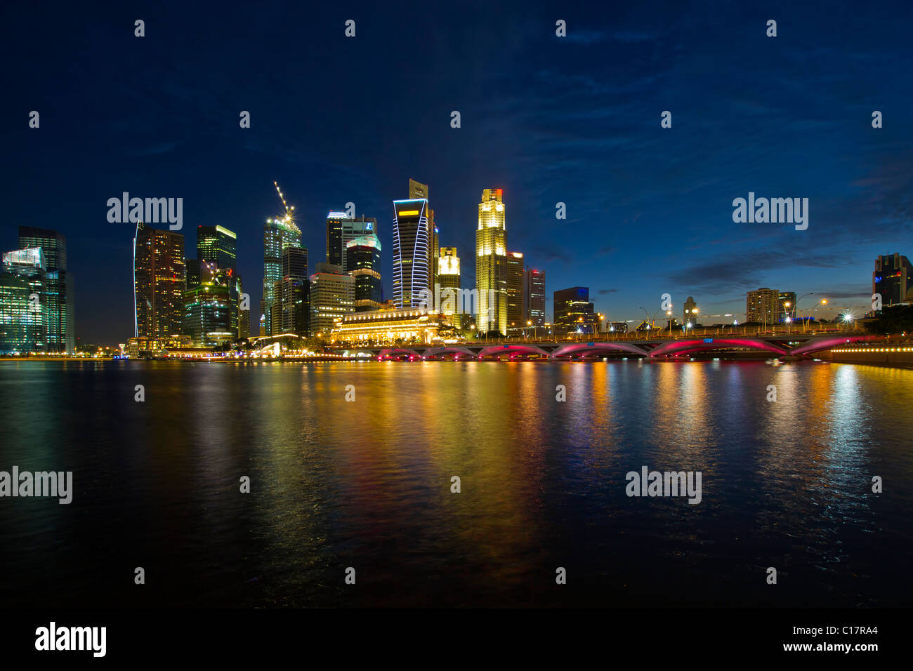 Singapore City Skyline by Marina Bay Esplanade at Blue Hour - Stock Image