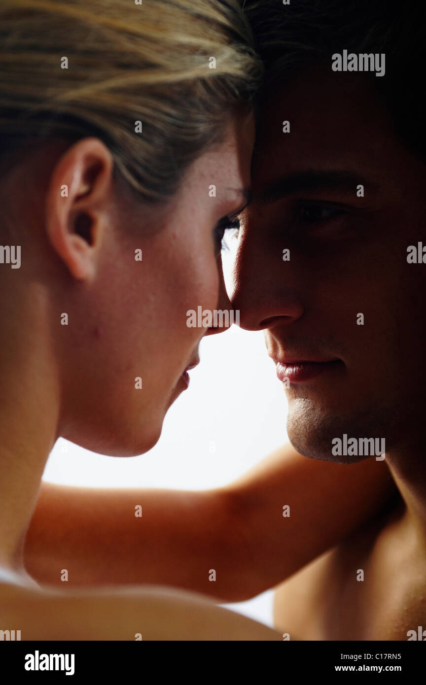 Lovers looking into each other's eyes, backlight - Stock Image