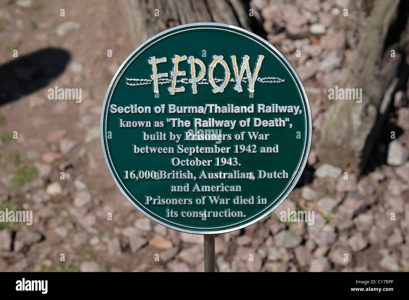 Sign beside a section of railway track, part of the Death Railway Memorial at the National Memorial Arboretum, Alrewas, - Stock Image