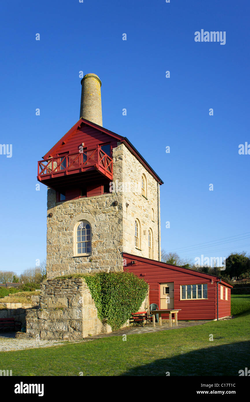 An old cornish tin mine engine house restored and being used as a holiday home near porthtowan in cornwall, uk - Stock Image