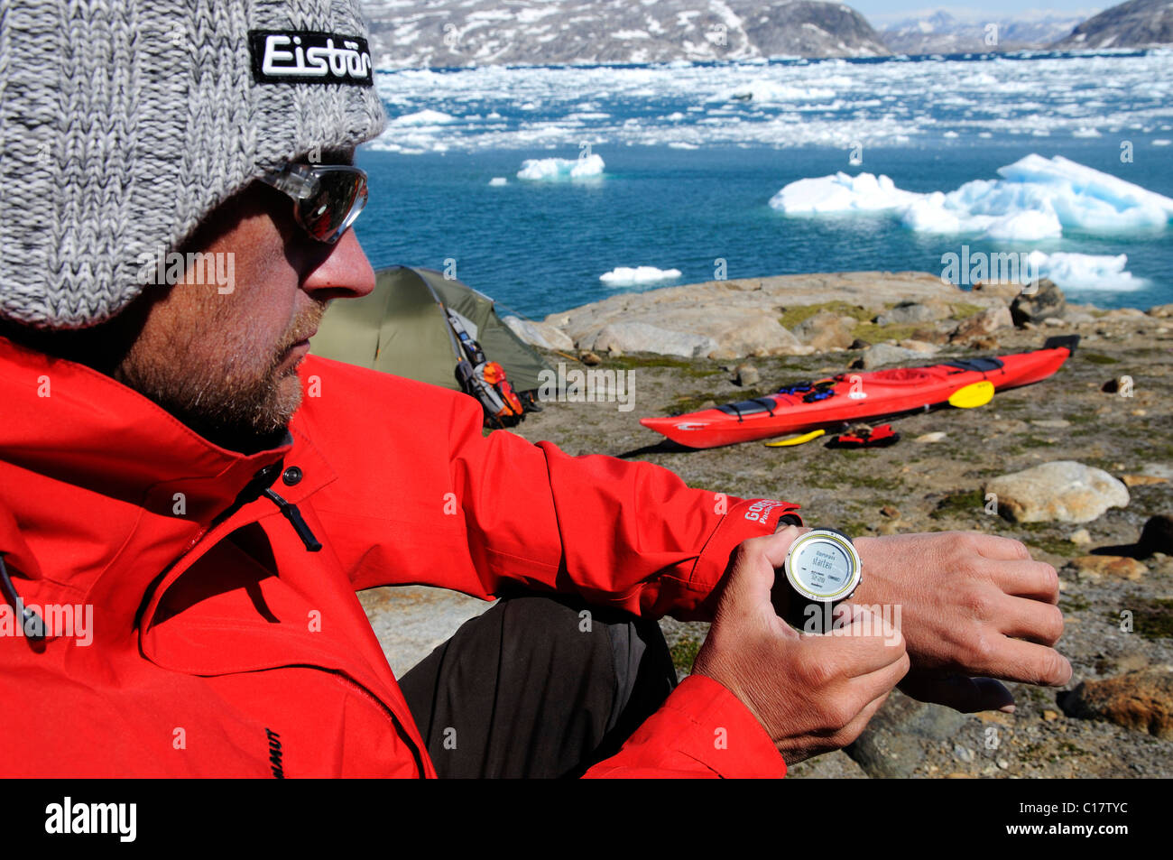 Compass, multifunction watch, kayaker camping in the Johan-Petersen-Fjord, East-Greenland, Greenland - Stock Image