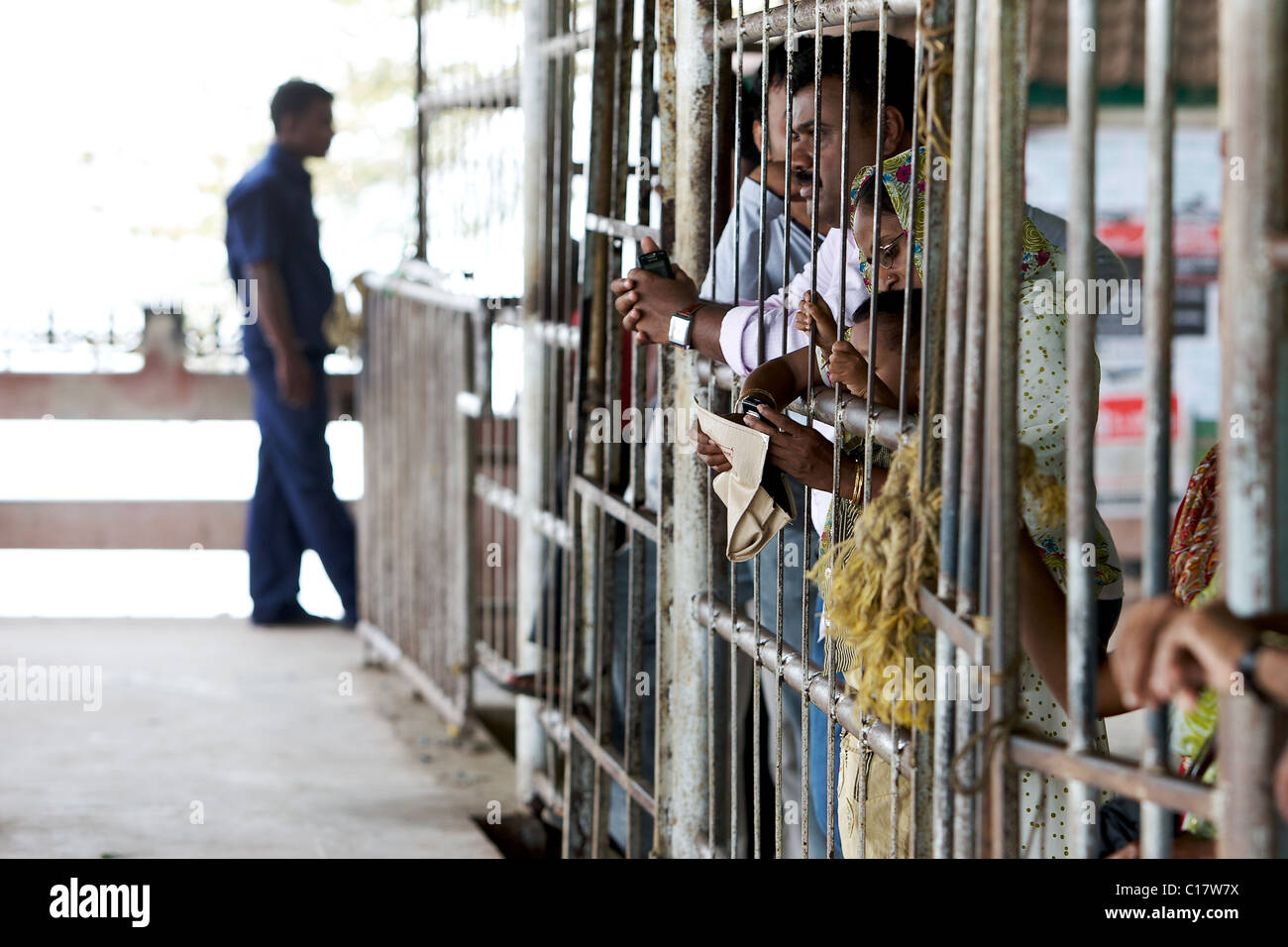 Waiting at the barrier at Fort Cochin ferry station - Stock Image