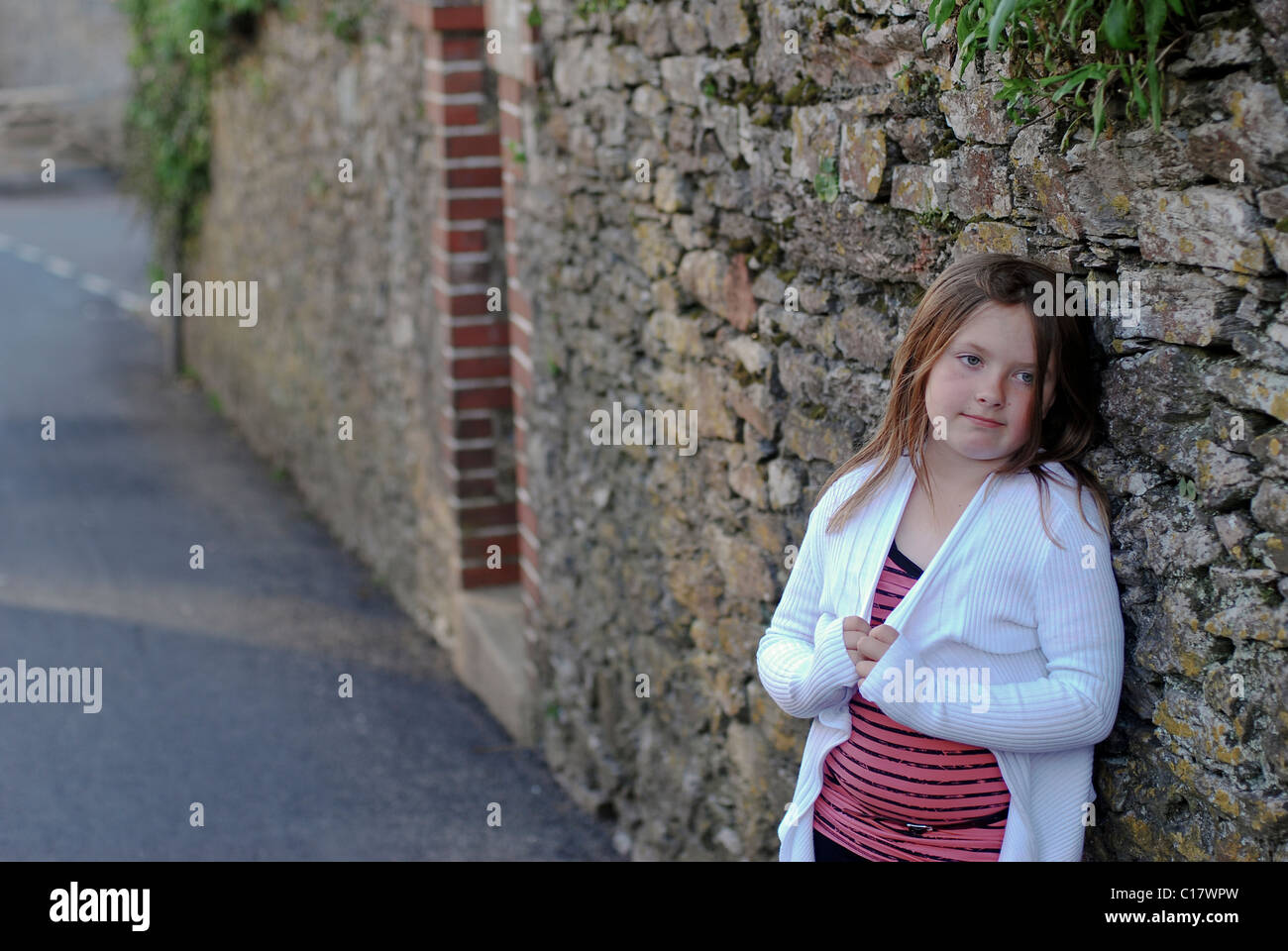 sad, moody, lonely  young girl, orphan, welfare, poor, lost - Stock Image