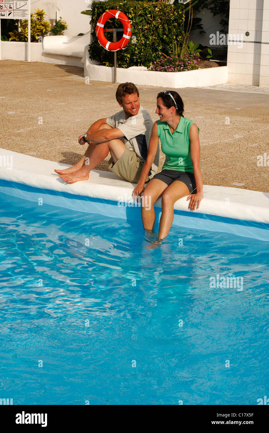 Tourists at the hotel pool, Medano, Tenerife, Canary Islands, Spain, Europe - Stock Image