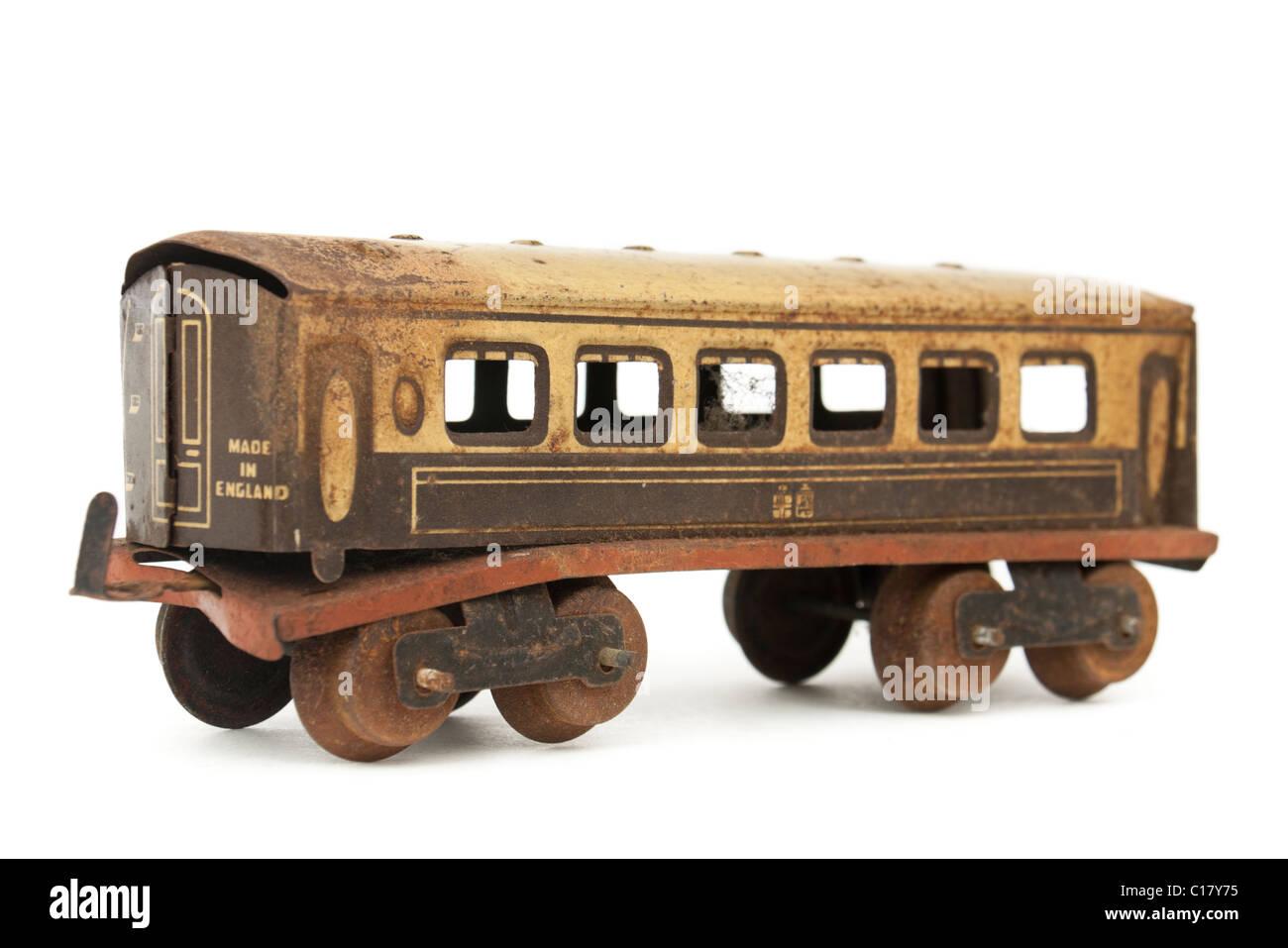 Early tinplate O-gauge 3-rail model railway passenger coach - Stock Image