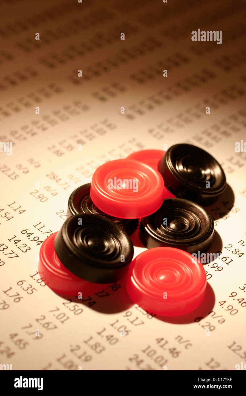 Checkers, draughts pieces on stock listings - Stock Image