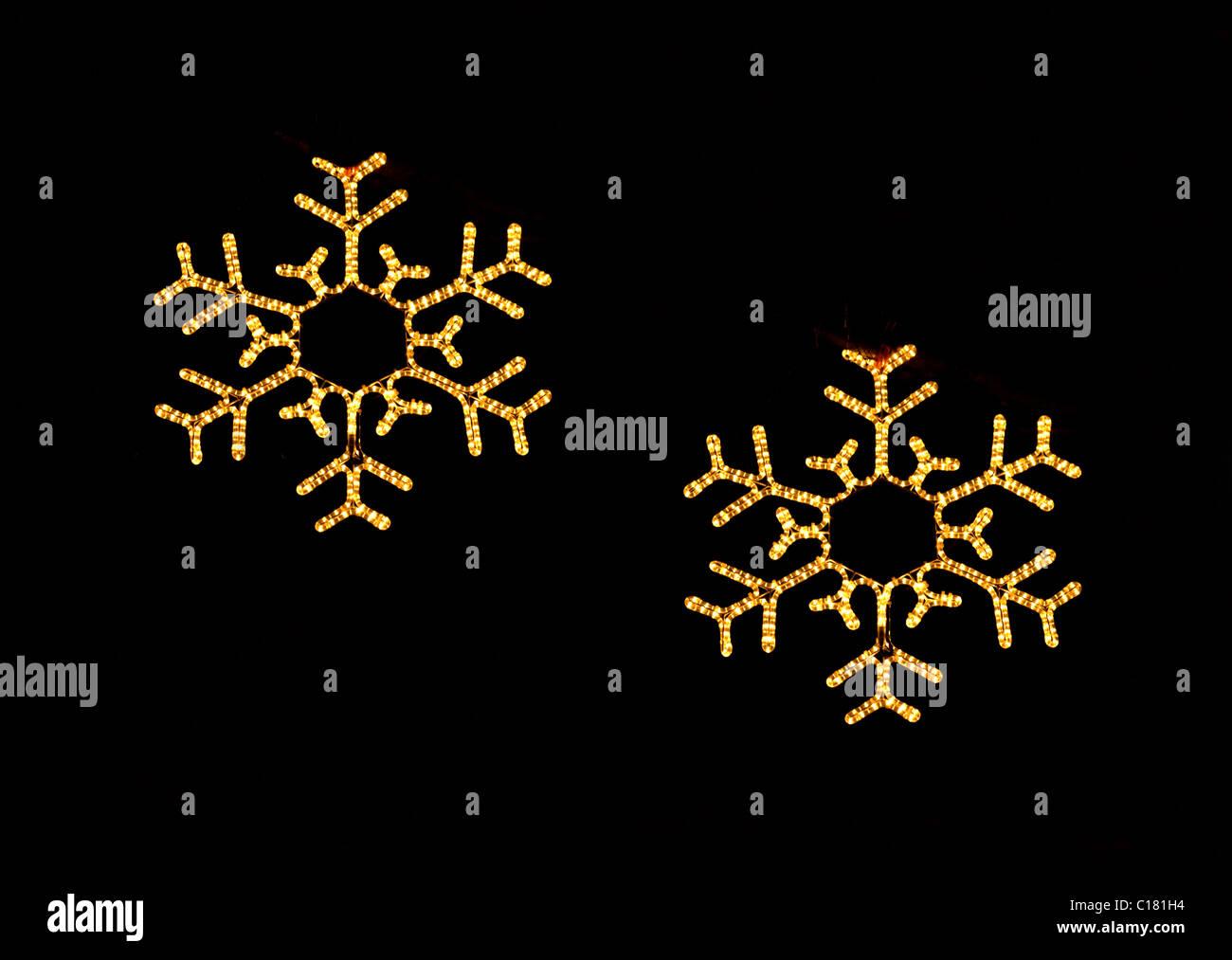 Christmas snowflake lights at Christmas in the dark - Stock Image