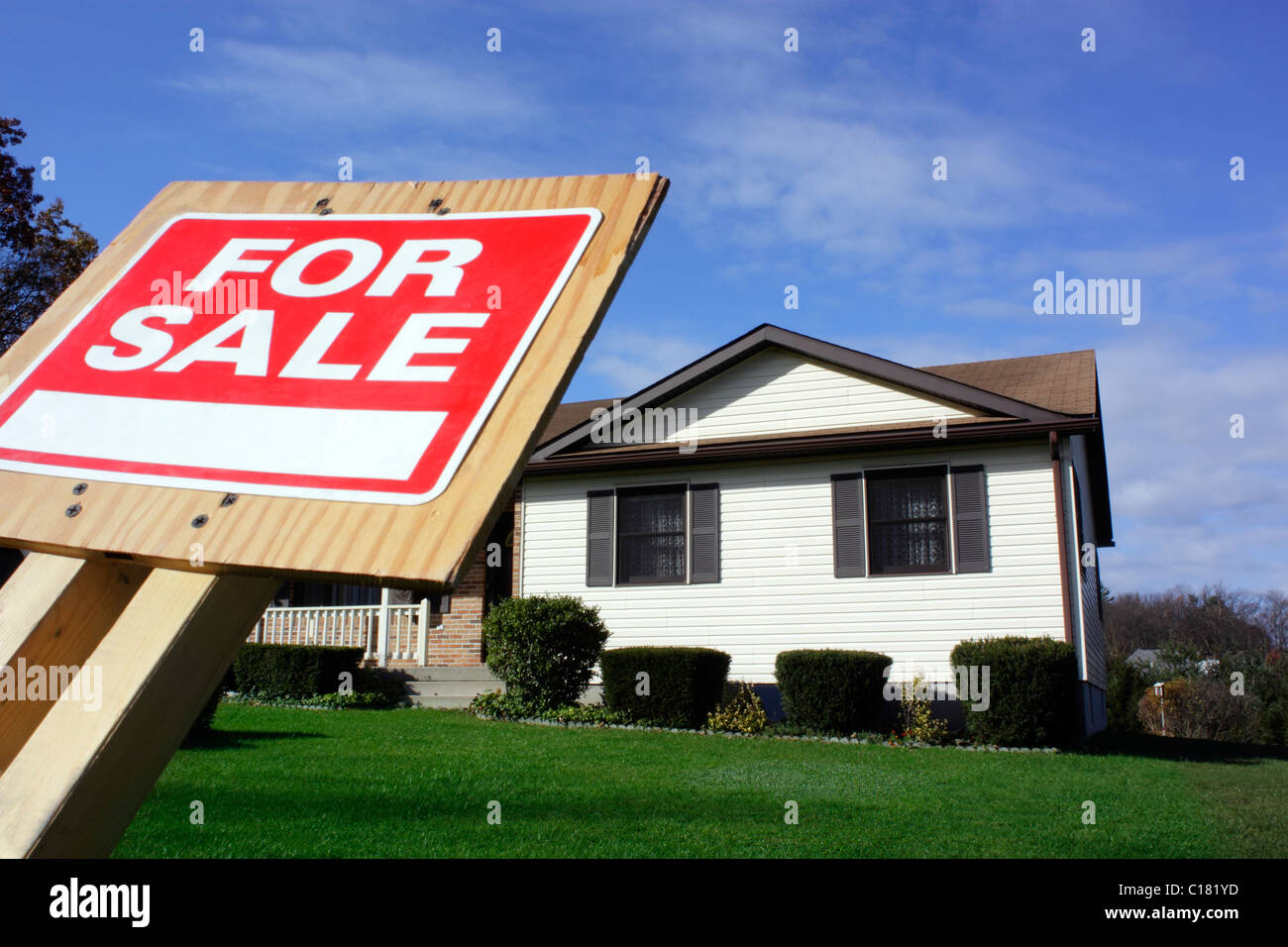 House with For Sale Sign Focus on For Sale Sign - Stock Image
